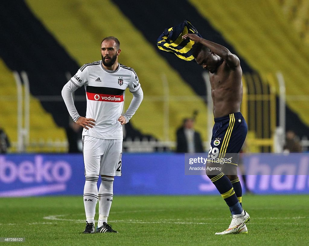 Emanuel Emenike of Fenerbahce (R) reacts after the audience's protest during the Turkish Spor Toto Super League match between Fenerbahce and Besiktas at Sukru Saracoglu Stadium in Istanbul, Turkey on March 22, 2015.