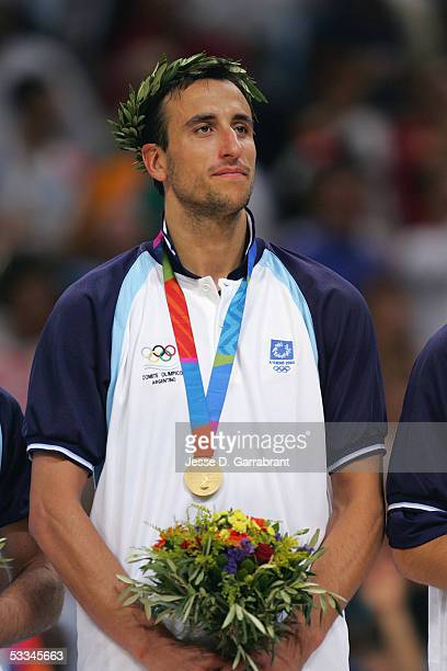 Emanuel Ginobili of Argentina looks on during the Men's Medal ceremony after defeating Italy for the Men's Gold Medal on August 28 2004 during the...