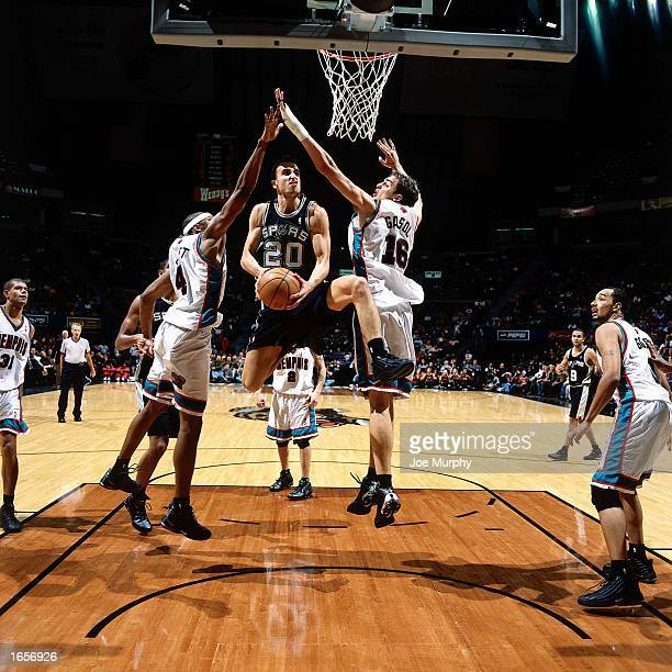 Emanuel Ginobili of the San Antonio Spurs drives to the basket against the Memphis Grizzlies at the Pyramid Arena on November 4 2002 in Memphis...