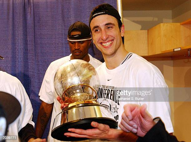 Emanuel Ginobili of the San Antonio Spurs with the Western Conference Championship Trophy after their win over the Dallas Mavericks in Game six of...