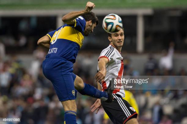 Emanuel Giocolioti of Boca heads the ball during a friendly match between Boca Juniors and River Plate at Azteca Stadium on May 31 2014 in Mexico...