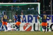Emanuel Herrera of Montpellier scores the first goal against Christoph Metzelder of Schalke and Timo Hildebrand of Schalke during the UEFA Champions...