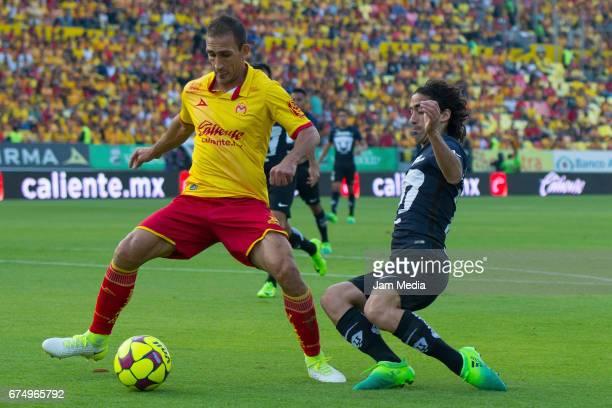 Emanuel Loeschbor of Morelia and Matias Britos of Pumas fight for the ball during the 16th round match between Morelia and Pumas as part of the...