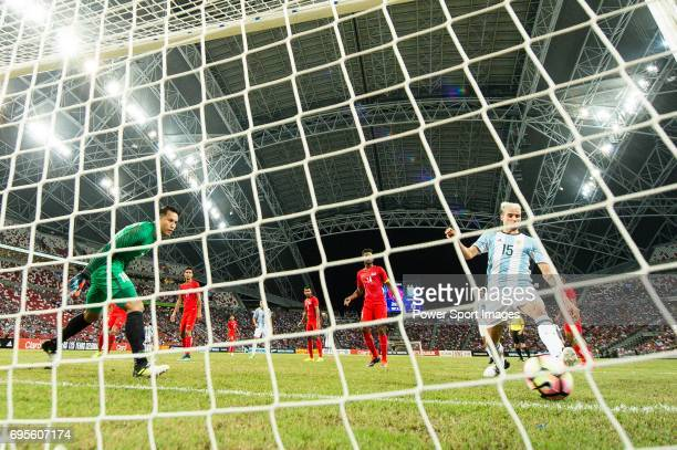 Emanuel Mammana of Argentina score his goal during the International Test match between Argentina and Singapore at National Stadium on June 13 2017...