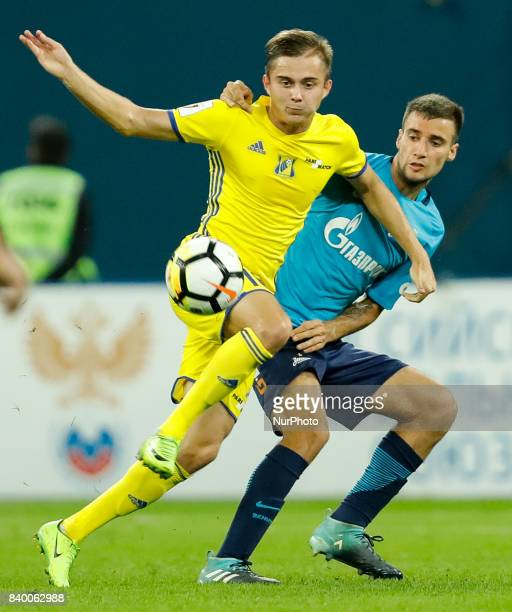 Emanuel Mammana of FC Zenit Saint Petersburg and Aleksandr Zuyev of FC Rostov vie for the ball during the Russian Football League match between FC...