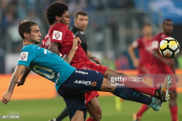 Emanuel Mammana of FC Zenit Saint Petersburg and Luis Adriano of FC Spartak Moscow vie for the ball during the Russian Football League match between...