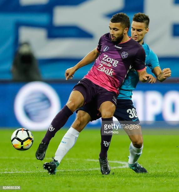 Emanuel Mammana of FC Zenit Saint Petersburg and Zakaria Labyad of FC Utrecht vie for the ball during the UEFA Europa League playoff round second leg...