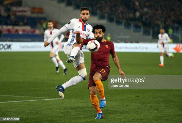 Emanuel Mammana of Lyon and Mohamed Salah of AS Roma in action during the UEFA Europa League Round of 16 second leg match between AS Roma and...