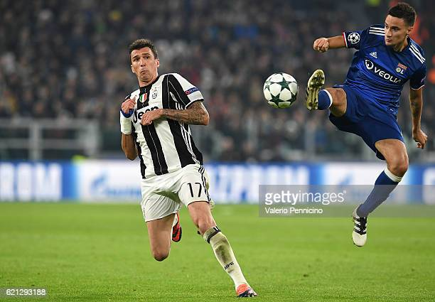 Emanuel Mammana of Olympique Lyonnais controls the ball against Mario Mandzukic of Juventus during the UEFA Champions League Group H match between...
