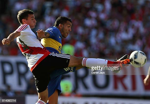 Emanuel Mammana of River Plate and Carlos Tevez of Boca Juniors vie for the ball during a match between River Plate and Boca Juniors as part of sixth...