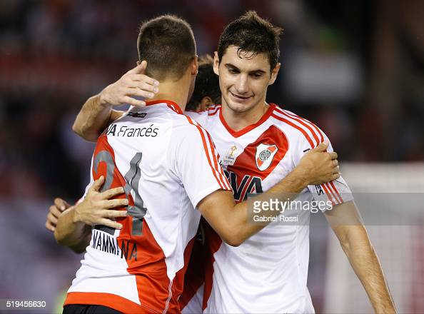 Emanuel Mammana of River Plate celebrates with teammate Lucas Alario after scoring the fourth goal of his team during a match between River Plate and...