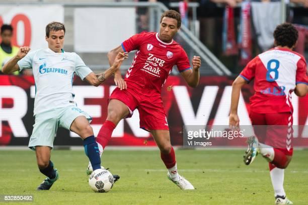 Emanuel Mammana of Zenit St Petersburg Cyriel Dessers of FC Utrecht during the UEFA Europa League fourth round qualifying first leg match between FC...