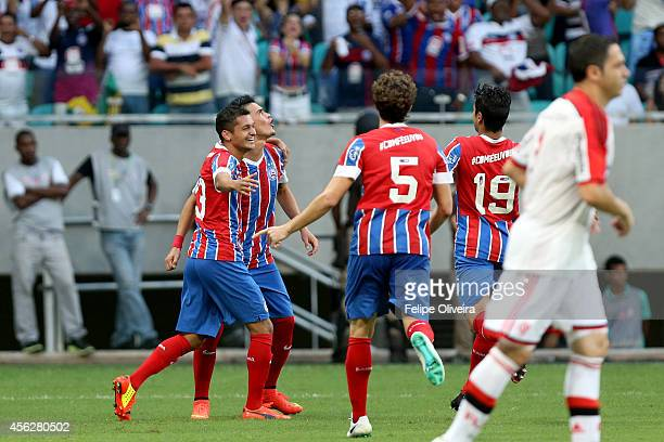 Emanuel of Bahia is mobbled by his team mates after scoring their goall during the match between Bahia and Flamengo as part of Brasileirao Series A...