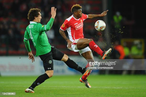 Emanuel Pogatetz of Hannover challenges Gohi Bi Cyriac of Liege during the UEFA Europa League group B match between R Standard de Liege and Hannover...