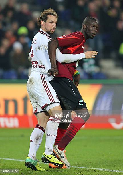 Emanuel Pogatetz of Nuremberg fights for the ball with Salif Sane of Hannover during the Bundesliga match between Hannover 96 and 1 FC Nuremberg at...