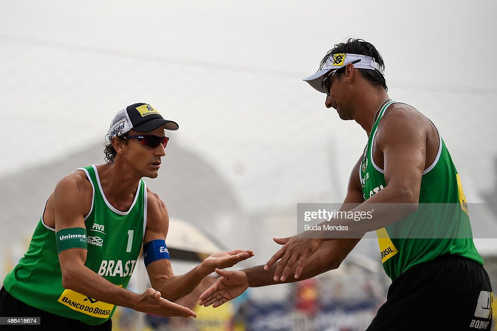 <a gi-track='captionPersonalityLinkClicked' href=/galleries/search?phrase=Emanuel+Rego&family=editorial&specificpeople=2263715 ng-click='$event.stopPropagation()'>Emanuel Rego</a> (L) and Ricardo Santos of Brazil celebrate a point during their match against Ramon Gomes and Lipe Rodrigues of Brazil at the FIVB Beach Volleyball World Tour Rio Open at Copacabana beach on September 3, 2015 in Rio de Janeiro, Brazil. This event serves as a test for Rio 2016.