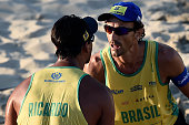 Emanuel Rego and Ricardo Santos of Brazil celebrate during their match against Nicholas Lucena and Theo Brunner of the United States at the Brazil v...