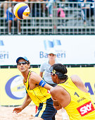 Emanuel Rego and Ricardo Santos of Brazil compete in the main draw match against Poland at Jose Correa Gymnasium during day five of the FIVB Sao...