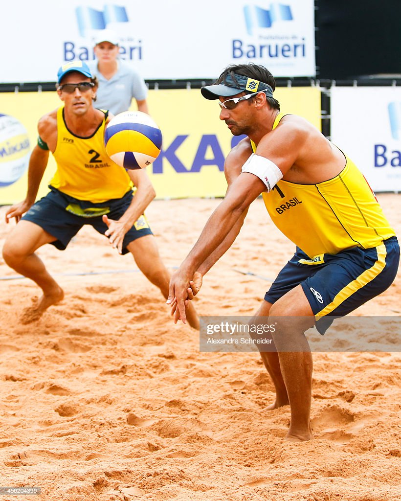 <a gi-track='captionPersonalityLinkClicked' href=/galleries/search?phrase=Emanuel+Rego&family=editorial&specificpeople=2263715 ng-click='$event.stopPropagation()'>Emanuel Rego</a> (left) and Ricardo Santos of Brazil compete in the main draw match against Poland at Jose Correa Gymnasium during day five of the FIVB Sao Paulo Grand Slam, on September 27, 2014 in Barueri, Brazil.