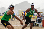 Emanuel Rego with Ricardo Santos of Brazil in action during his match against Ramon Gomes and Lipe Rodrigues of Brazil at the FIVB Beach Volleyball...