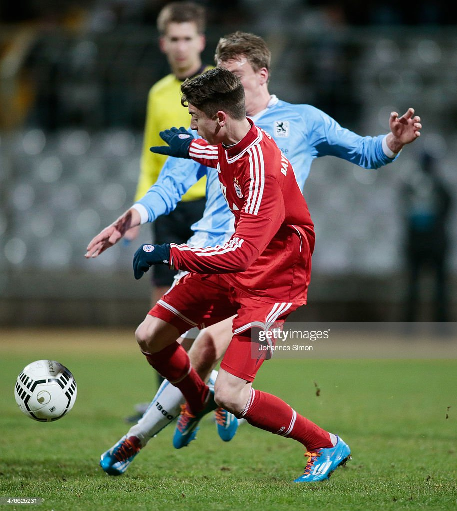 Emanuel Taffertshofer (L) of 1860 Muenchen battles for the ball with Lucas Scholl of FC Bayern during the A Juniors Bundesliga match between 1860 Muenchen and Bayern Muenchen at Stadion an der Gruenwalder Strasse on February 21, 2014 in Munich, Germany.