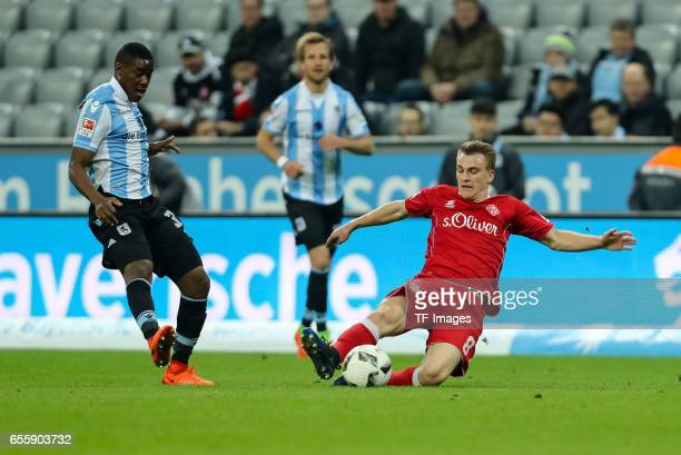 Emanuel Taffertshofer of FC Wuerzburger Kickers und Romuald Lacazette of 1860 Munich battle for the ball during the Second Bundesliga match between...