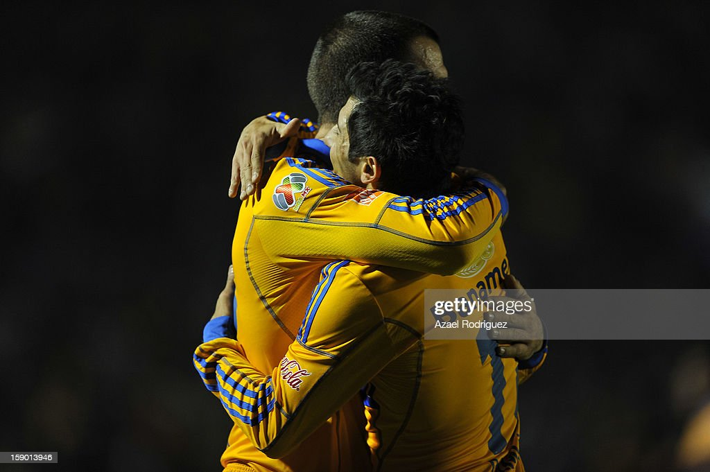 <a gi-track='captionPersonalityLinkClicked' href=/galleries/search?phrase=Emanuel+Villa&family=editorial&specificpeople=3061294 ng-click='$event.stopPropagation()'>Emanuel Villa</a> celebrates a goal with <a gi-track='captionPersonalityLinkClicked' href=/galleries/search?phrase=Dami%C3%A1n+%C3%81lvarez&family=editorial&specificpeople=866281 ng-click='$event.stopPropagation()'>Damián Álvarez</a> during the match between Tigres and Jaguares as part of theClausura 2013 championship at Universitario Stadium on January 05, 2013 in Monterrey, Mexico.