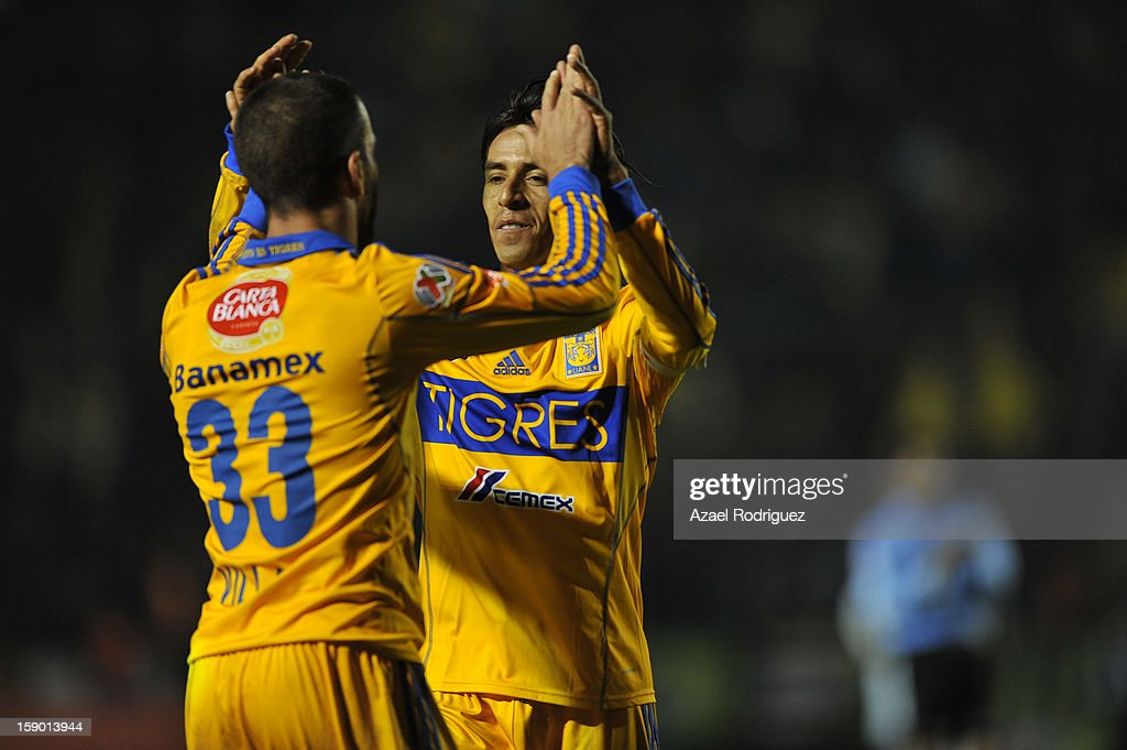 <a gi-track='captionPersonalityLinkClicked' href=/galleries/search?phrase=Emanuel+Villa&family=editorial&specificpeople=3061294 ng-click='$event.stopPropagation()'>Emanuel Villa</a> celebrates a goal with Lucas Lobos during the match between Tigres and Jaguares as part of theClausura 2013 championship at Universitario Stadium on January 05, 2013 in Monterrey, Mexico.