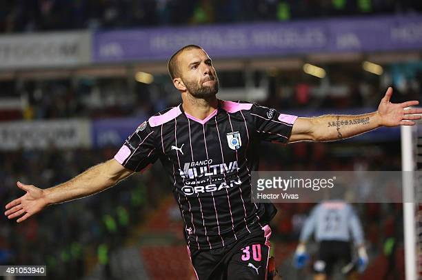 Emanuel Villa of Queretaro celebrates after scoring the second goal of his team during the 12th round match between Queretaro and Tijuana as part of...
