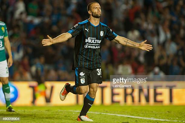 Emanuel Villa of Queretaro celebrates after scoring the third goal of his team during a 10th round match between Queretaro and Leon as part of the...