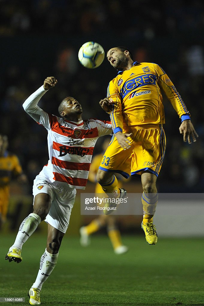 Emanuel Villa of Tigres fights for the ball during the match between Tigres and Jaguares as part of theClausura 2013 championship at Universitario Stadium on January 05, 2013 in Monterrey, Mexico.