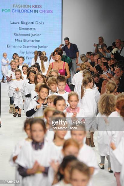 Emanuela Folliero and some young girls and boys walk the runway at the Fashion Kids For 'Children In Crisis' Spring/Summer 2012 fashion show as part...