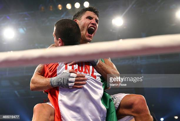 Emanuele Blandamura of Italy celebrates after winning over Marcos Nader of Austria the middle weight fight on January 25 2014 in Stuttgart Germany