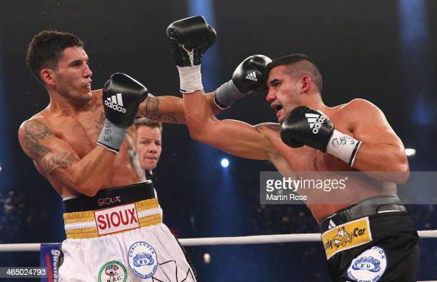 Emanuele Blandamura of Italy exchanges punches with Marcos Nader of Austria during their middle weight fight on January 25 2014 in Stuttgart Germany