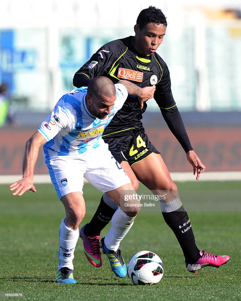 Emanuele Blasi of Pescara and Fernando Muriel of Udinese in action during the Serie A match between Pescara and Udinese Calcio at Adriatico Stadium on March 3, 2013 in Pescara, Italy.