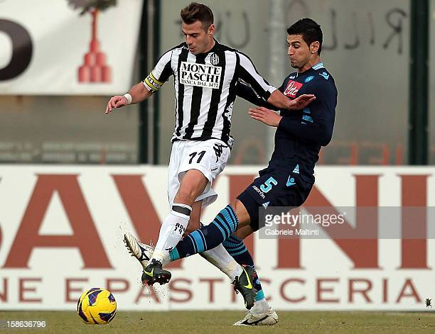 Emanuele Calaio' of AC Siena fights for the ball with Miguel Angel Britos of SSC Napoli during the Serie A match between AC Siena and SSC Napoli at...