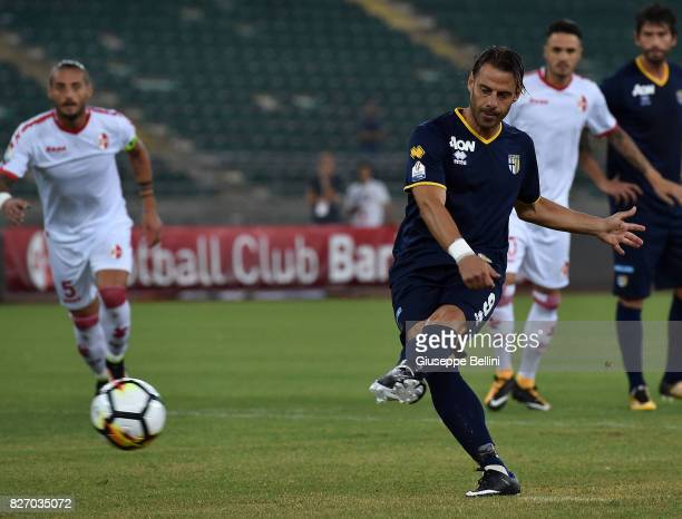 Emanuele Calaio' of Parma Calcio kicks the penalty and scores the opening goal during the TIM Cup match between AS Bari and Parma Calcio at Stadio...