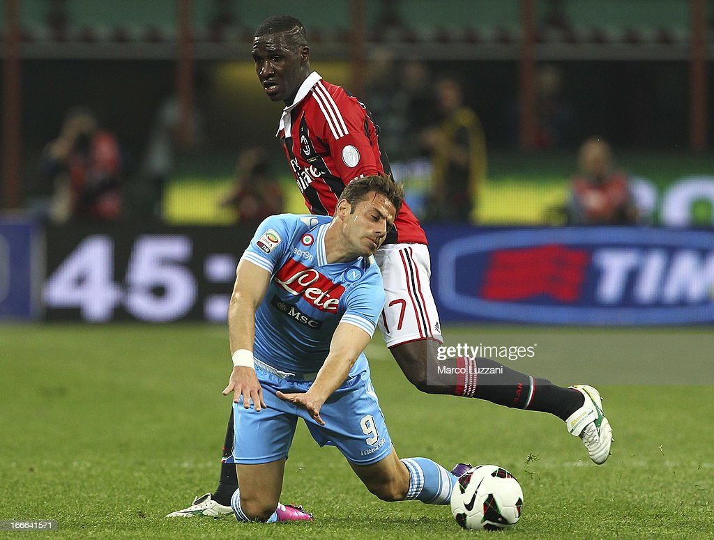 Emanuele Calaio'of SSC Napoli competes for the ball with <a gi-track='captionPersonalityLinkClicked' href=/galleries/search?phrase=Cristian+Zapata&family=editorial&specificpeople=854055 ng-click='$event.stopPropagation()'>Cristian Zapata</a> of AC Milan during the Serie A match between AC Milan and SSC Napoli at San Siro Stadium on April 14, 2013 in Milan, Italy.