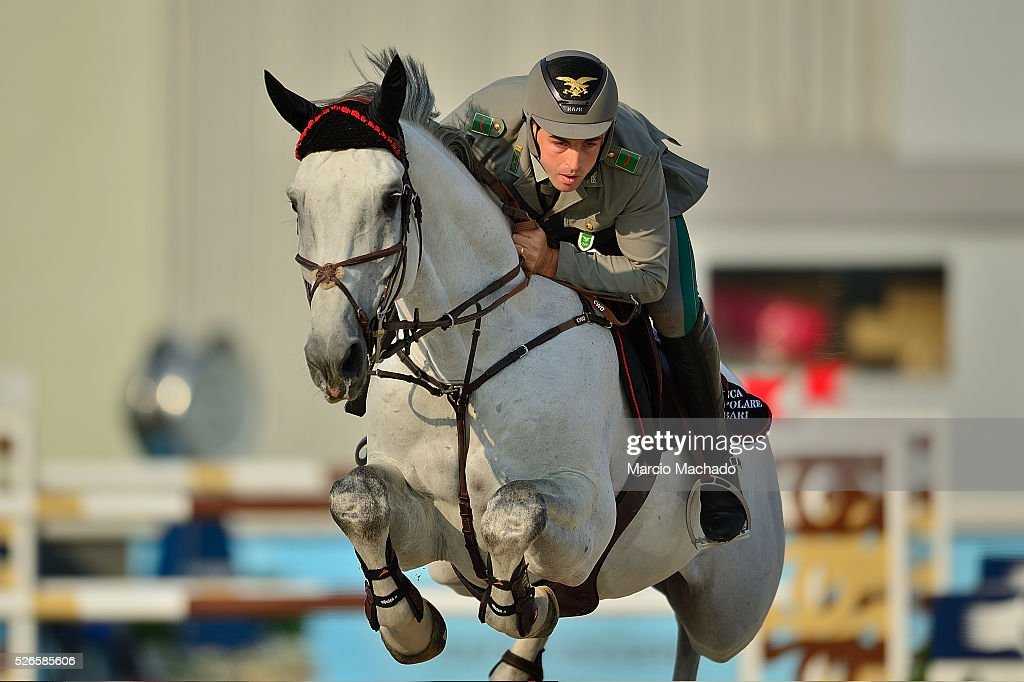 Emanuele Gaudiano of Italy hiding Caspar 232 during the Longines Global Champions Tour of Shanghai day 2 jump-off 1.60 m height on April 30, 2016 in Shanghai, China.