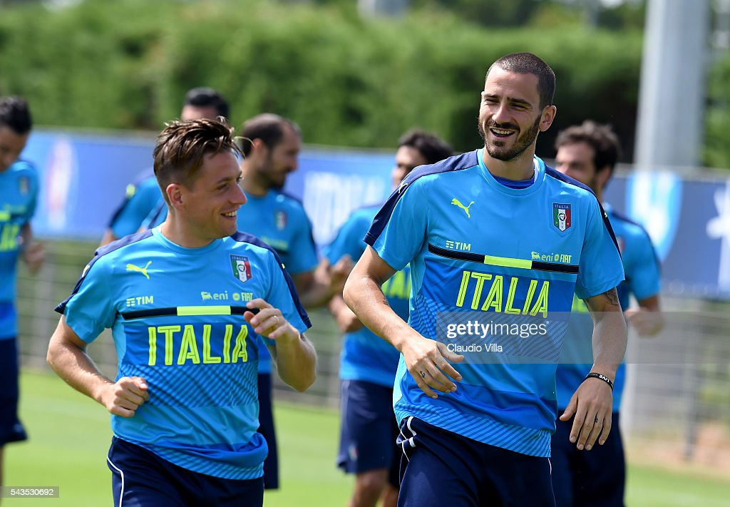 <a gi-track='captionPersonalityLinkClicked' href=/galleries/search?phrase=Emanuele+Giaccherini&family=editorial&specificpeople=6675873 ng-click='$event.stopPropagation()'>Emanuele Giaccherini</a> (L) and <a gi-track='captionPersonalityLinkClicked' href=/galleries/search?phrase=Leonardo+Bonucci&family=editorial&specificpeople=6166090 ng-click='$event.stopPropagation()'>Leonardo Bonucci</a> of Italy chat during the training session at 'Bernard Gasset' Training Center on June 29, 2016 in Montpellier, France.