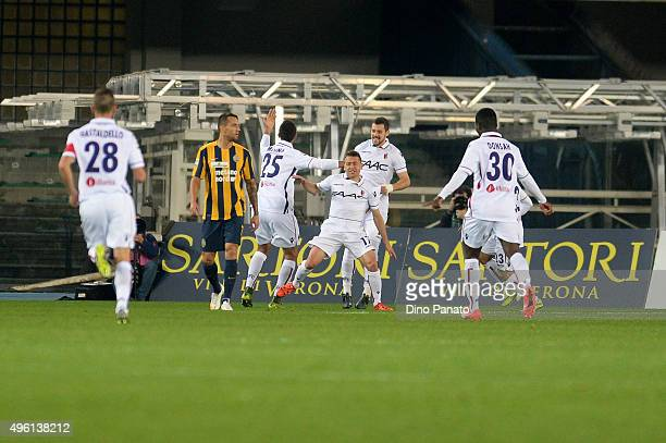Emanuele Giaccherini of Bologna FC celebrate wit his team mate's after scoring his opening goal during the Serie A match between Hellas Verona FC and...