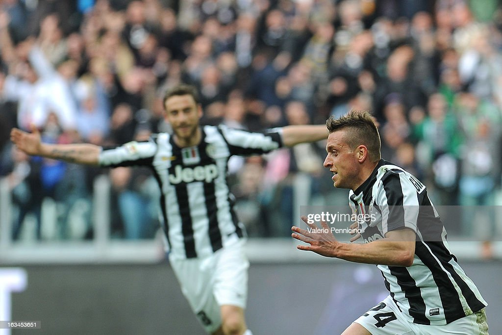 Emanuele Giaccherini (R) of FC Juventus celebrates his goal during the Serie A match between FC Juventus and Calcio Catania at Juventus Arena on March 10, 2013 in Turin, Italy.