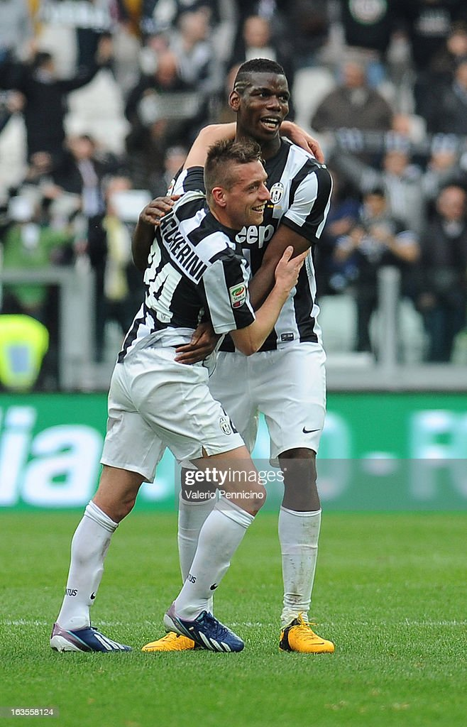 Emanuele Giaccherini (L) of FC Juventus celebrates victory with his team mates Paul Pogba at the end of the Serie A match between FC Juventus and Calcio Catania at Juventus Arena on March 10, 2013 in Turin, Italy.