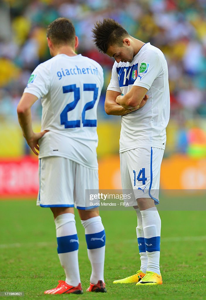 <a gi-track='captionPersonalityLinkClicked' href=/galleries/search?phrase=Emanuele+Giaccherini&family=editorial&specificpeople=6675873 ng-click='$event.stopPropagation()'>Emanuele Giaccherini</a> of Italy and <a gi-track='captionPersonalityLinkClicked' href=/galleries/search?phrase=Stephan+El+Shaarawy&family=editorial&specificpeople=7181554 ng-click='$event.stopPropagation()'>Stephan El Shaarawy</a> react during the FIFA Confederations Cup Brazil 2013 3rd Place match between Uruguay and Italy at Estadio Octavio Mangabeira (Arena Fonte Nova Salvador) on June 30, 2013 in Salvador, Brazil.