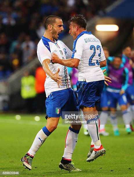 Emanuele Giaccherini of Italy celebrates scoring his team's first goal with his team mate Leonardo Bonucci during the UEFA EURO 2016 Group E match...