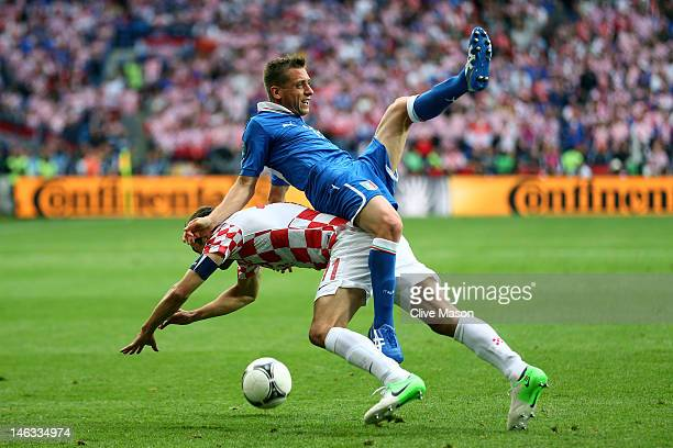 Emanuele Giaccherini of Italy clashes with Darijo Srna of Croatia during the UEFA EURO 2012 group C match between Italy and Croatia at The Municipal...