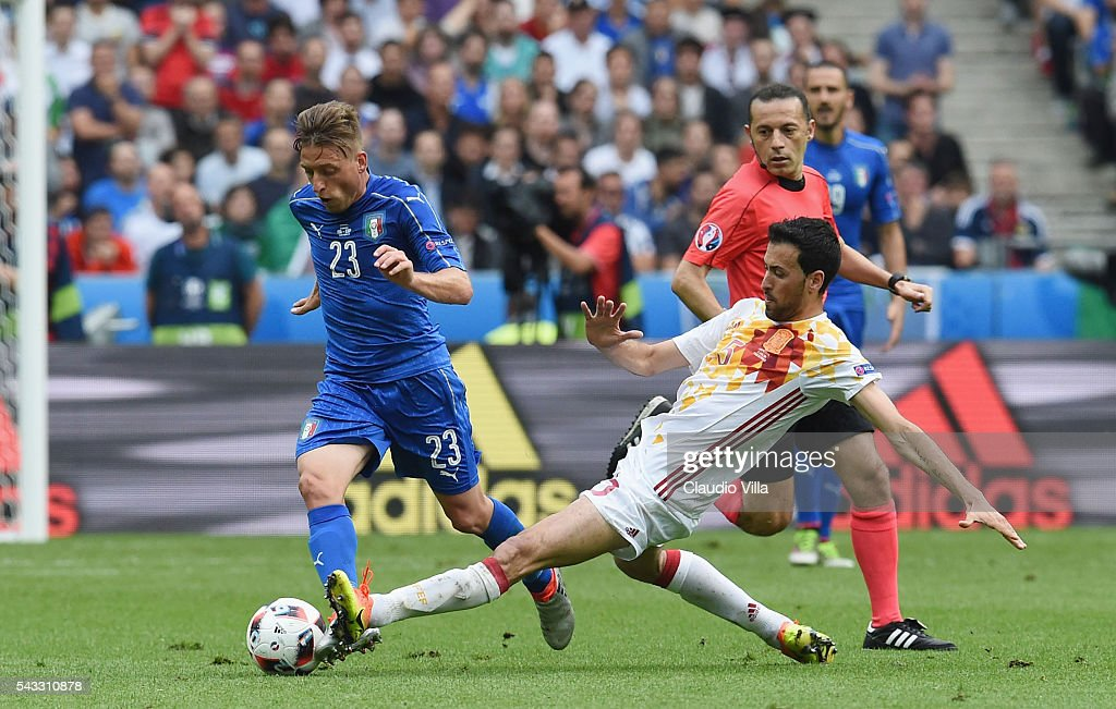 <a gi-track='captionPersonalityLinkClicked' href=/galleries/search?phrase=Emanuele+Giaccherini&family=editorial&specificpeople=6675873 ng-click='$event.stopPropagation()'>Emanuele Giaccherini</a> of Italy is tackled by <a gi-track='captionPersonalityLinkClicked' href=/galleries/search?phrase=Sergio+Busquets&family=editorial&specificpeople=5477015 ng-click='$event.stopPropagation()'>Sergio Busquets</a> of Spain during the UEFA EURO 2016 round of 16 match between Italy and Spain at Stade de France on June 27, 2016 in Paris, France.