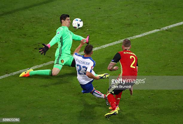 Emanuele Giaccherini of Italy scores his team's first goal past Thibaut Courtois of Belgium during the UEFA EURO 2016 Group E match between Belgium...