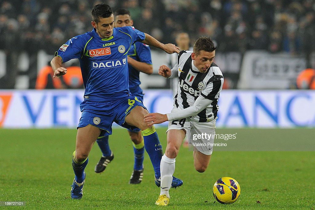 <a gi-track='captionPersonalityLinkClicked' href=/galleries/search?phrase=Emanuele+Giaccherini&family=editorial&specificpeople=6675873 ng-click='$event.stopPropagation()'>Emanuele Giaccherini</a> (R) of Juventus is challenged by <a gi-track='captionPersonalityLinkClicked' href=/galleries/search?phrase=Giampiero+Pinzi&family=editorial&specificpeople=2164981 ng-click='$event.stopPropagation()'>Giampiero Pinzi</a> of Udinese Calcio during the Serie A match between Juventus and Udinese Calcio at Juventus Arena on January 19, 2013 in Turin, Italy.