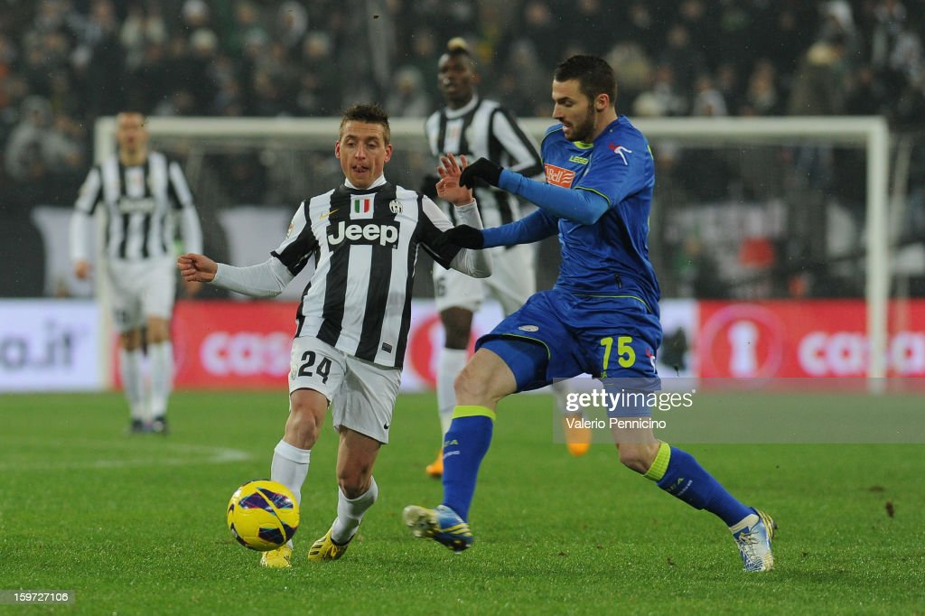 <a gi-track='captionPersonalityLinkClicked' href=/galleries/search?phrase=Emanuele+Giaccherini&family=editorial&specificpeople=6675873 ng-click='$event.stopPropagation()'>Emanuele Giaccherini</a> (L) of Juventus is challenged by <a gi-track='captionPersonalityLinkClicked' href=/galleries/search?phrase=Thomas+Heurtaux&family=editorial&specificpeople=7140770 ng-click='$event.stopPropagation()'>Thomas Heurtaux</a> of Udinese Calcio during the Serie A match between Juventus and Udinese Calcio at Juventus Arena on January 19, 2013 in Turin, Italy.